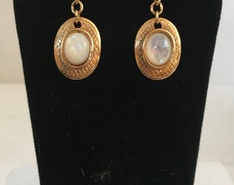 Gold plated brass oval stud earrings with oval mother of pearl stones