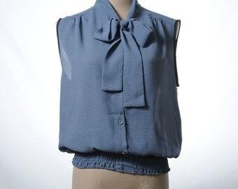 Vintage sleeveless bow tie top with elastic waist