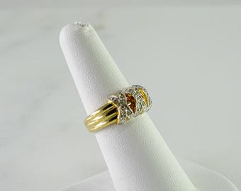 Three Diamond X's on a 14 kt Gold Ring size 7