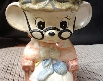 Grandma mouse sitting knitting coin bank