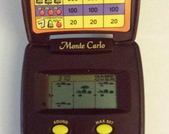 Triple Seven Slot Pocket LCD Game by Radica