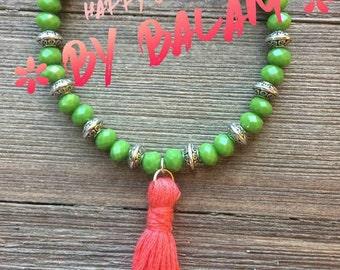 Green Czech crystal with handmade tassel