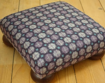 Bespoke upholstered beech bun footstool covered in a light and dark purple wool fabric, Square footstool, Low stool, Wooden footstool