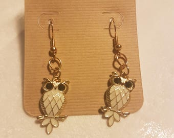 Gold dangle earrings with owls