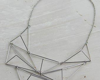 Geometrical statement bib necklace in silver tone