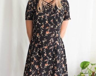 vintage black floral dress with criss-cross detailing