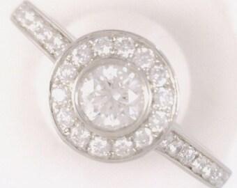 Gorgeous Round Brilliant Cut Diamond Halo Ring. In Solid Platinum.