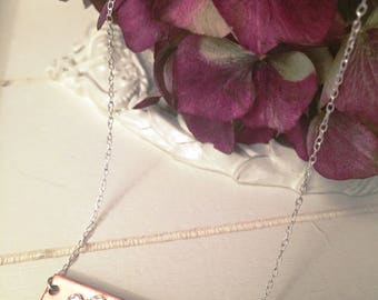 Rose gold coloured copper bar necklace set with tiny silver coloured Swarovski crystals