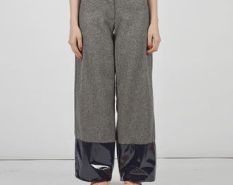 Cloth trousers with patent leather bottom