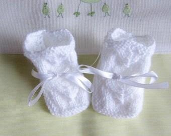 White baby booties in newborn - hand made knit