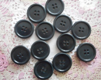 Black round acrylic 4 buttons holes 2.50 cm in diameter (with 12 buttons)