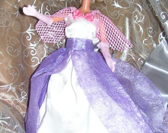 Dress Barbie in harmonies of mauve pink