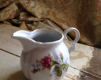 Creamer with rosebuds and gold trim.