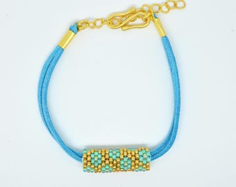 Turquoise leather and Myuki seed bead bracelet. Blue and gold flower beading