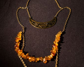 Multi strand necklace amber pendant half moon