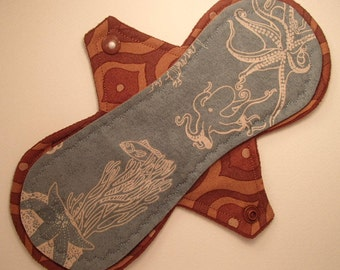 """9"""" light cloth pad,  octopus and coral, reusable cloth menstrual pad, exposed core, windpro fleece, flannel core, 2.5"""" snapped width"""
