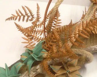 Floral centerpiece. Origami Flowers combined with natural branch. Ideal to decorate with originality a space. Original design.