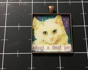 100% Donation: White Cat Pendant, Adopt a Deaf Pet, Double blue swirled glitter, all proceeds go to the current selected animal charity