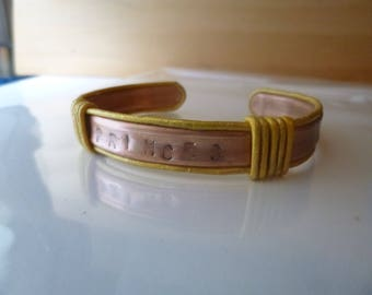 Future Queen copper bracelet trimmed and wrapped with gold leather and has princess stamped in the front