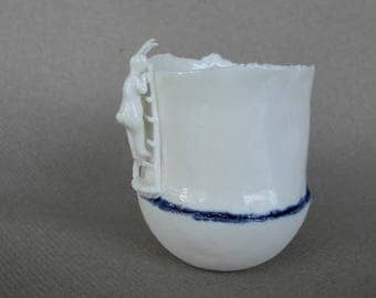 Cup in white porcelain with a rabbit  on a ladder - handmade ceramic whimsical vessel