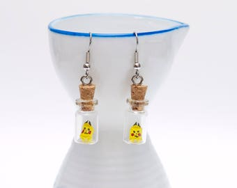 Origami pikachu in tiny glass bottle earrings