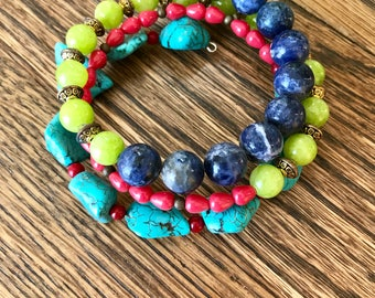 Beaded Memory wire bracelet with Iolite, quartz, coral, glass, turquoise colored howlite beads. Multi strand look bright colors