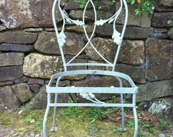 Set of four vintage blue oak leaf wrought iron garden chairs