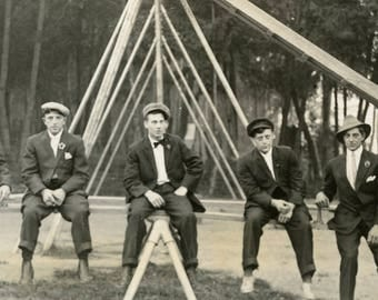 Men in Hats Sitting On TRIANGULAR SHAPED GEOMETRIC Design in Abstract Photo Postcard circa 1910