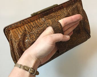 1930s vintage reptile skin clutch bag with finger strap and decorative brass clasp