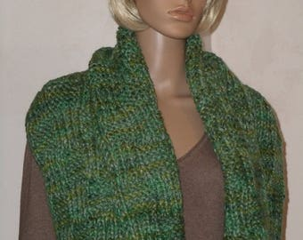 Knitted green warm scarf