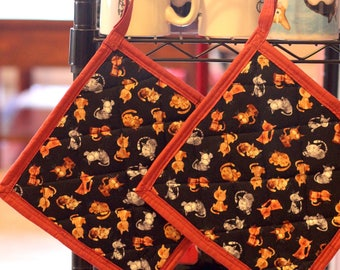 100% cotton quilted potholders in adorable cat print with warm accents