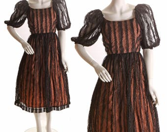 Early 1970s Does 1950s Nude Illusion Sheer Black Lace Gothic Dramatic Sleeve Dress by Lee Jordan-