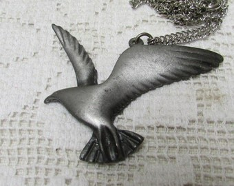IT's Jonathan! Pewter seagull necklace of 70's icon Johnathan Livingston Seagull.