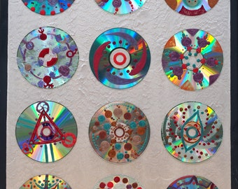 CROP CIRCLES paint on cds stick on a pearly canvas