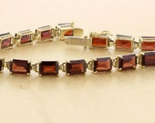 Classy 14K Yellow Gold Bracelet with Emerald cut Garnets