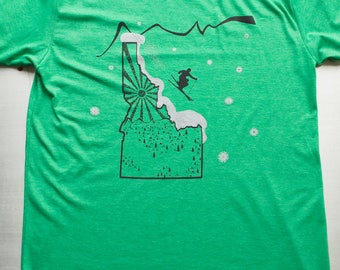 Ski Idaho, Idaho shirt printed on soft 50/50 t-shirts. Idaho gift in green, blue, grey, xs,s,m,l,xl,xxl. ski Idaho shirt, mountain, nature.