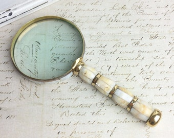 Vintage brass and mother of pearl magnifying glass