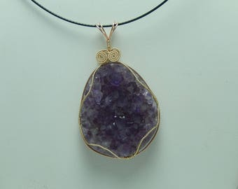 Amethyst crystal wire wrapped pendant.