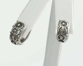 Pair of Sterling Silver Huggie Earrings With Circular Geometric Embellishments