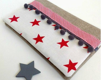Fabric coated, fabric checkbook red stars on white background, border tassels through graphic and gray