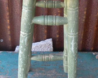 vintage stool, green crusty paint, bottle cap art, cabin decor, from Diz Has Neat Stuff