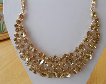 Gold Tone Bib Necklace with Gold Crystal Like Beads and Gold Rhinestones