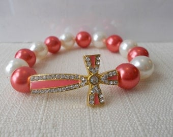 White and Peach Sea Shell Pearl Stretch Bracelet with a Gold, Peach and Clear Rhinestone Cross
