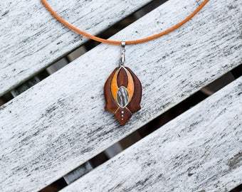 Abalone shell, resin, sterling silver and wood pendant. Handmade jewelry necklace pendant. Woodart