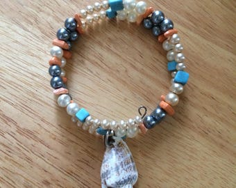 Atlantic conch shell with natural coral and vintage faux pearls memory wire bracelet