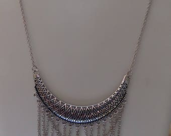Connector bib necklace ethnic silver metal, form half moon geometric patterns, draped chain link oval silver plate.