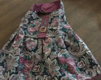 This is an adorable fall dress with a cotton blend material in a mauve and green mixes flowers.