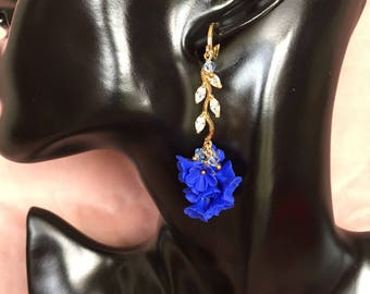 Earrings plated gold with oxide of zirconium