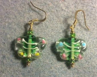 Green and pink lampwork butterfly bead earrings adorned with green Chinese crystal beads.