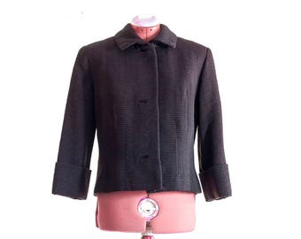 1950s dark brown jacket with cropped sleeves, a Vogue Couturier design